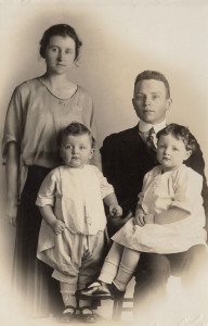 Grace, Herb, little Lois and Jim Tompkins, about 1921